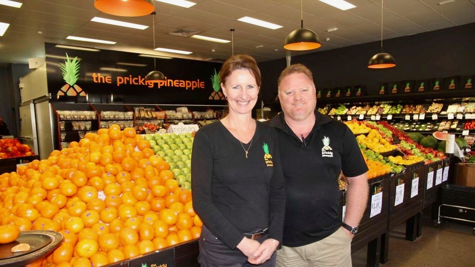 PHOTO: Owners of Airlie Beach fruit shop The Prickly Pineapple Jen and Jamie Fuhrmann